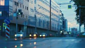 Rainy spring morning street, car lights, traffic lights signals