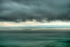 Rainy storm cloud over the lake (HDR) Royalty Free Stock Photography