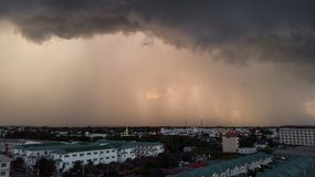 Rainy storm with grain over the city. Dark sky and dramatic cloud before rain in rainy season stock photography
