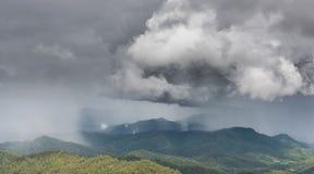 Rainy storm over the mountain Stock Photos