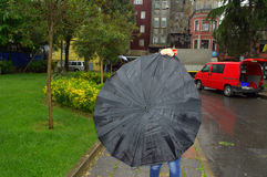 Rainy street black umbrella Royalty Free Stock Photo