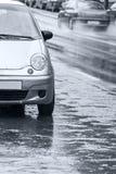 Rainy street and cars Royalty Free Stock Image