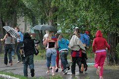 Rainy summer day. Summer camp for children and teenagers, rainy summer day. Children hurry to hide from the rain Royalty Free Stock Photo