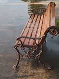 Rainy summer day in the park. Bench in the park on raining day Stock Photography