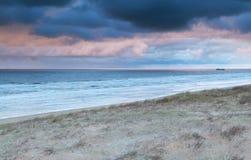 Rainy sundown over north sea coast Royalty Free Stock Photo