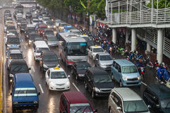 Rainy traffic jam. Crowded traffic jam in urban street in bad weather Royalty Free Stock Photography