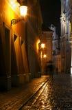 Rainy walk the cobbled street at night Royalty Free Stock Photo