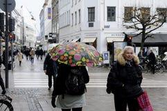 RAINY WEATHER. Copenhagen / Denmark_ 09th. November 2016 _  Shoppers and travelers under umbreallas danish weather rainy day in Copenhagen , Denmark      Photo Royalty Free Stock Photo