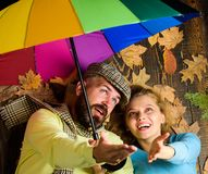 Rainy weather not obstacle for them. Couple dating. Hipster with beard and cheerful girl expect rainy weather hold. Colorful umbrella. Man bearded and blonde royalty free stock photo