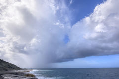 Rainy weather over tropical sea Royalty Free Stock Images
