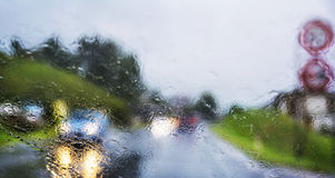 Rainy weather on the road and traffic Stock Image