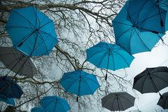 Rainy weather and umbrellas. At the sky background stock photos