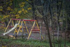 Rainy muddy children playground with cloudy day stock images