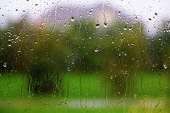 Rainy Window. Looking out of window in rain. Focus on the rain drops on the glass Stock Photography