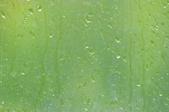 Rainy window blur. Water drops on glass Royalty Free Stock Photography