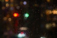 Rainy window at night. Close up Stock Photo