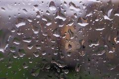 Rainy window. Rain drops on the window.nClose detail of water drops on the window on a rainy day Stock Photo