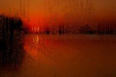 Rainy window at sunset Stock Photo