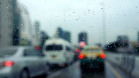 Rainy window in traffic with blur scene Royalty Free Stock Image
