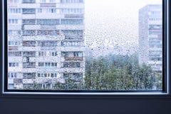 Rainy window, urban view. Soft focus Stock Photos