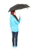 Rainy young woman in blue, full length Royalty Free Stock Photos