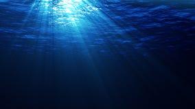 Raios de sol que quebram através da água do mar ilustração stock