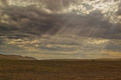 Raios de Sun na terra seca Foto de Stock Royalty Free