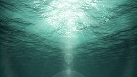 Raios subaquáticos de Sun no oceano (laço) filme