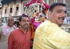 Raipur, Ahmedabad 5 April, 2012 - Lord Hatkeshwar. Nagar Brahmin Hindu priests carrying Lord Shiva Hatkeshwar on chariot out into the city for appearance among Stock Images