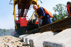 Rairoad Workers. KYIV REGION, UKRAINE - AUGUST 21: Repair workers modernize the 1, 000th km of Irpin-Bucha railway line on August 21, 2007 in Kyiv region stock photos