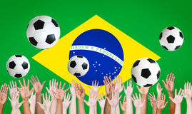 Raised Arms and Brazilian Flag for World Cup Royalty Free Stock Photos