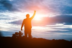 Raised arms man against beautiful sunset. Raised arms man against beautiful sunset background Stock Photography