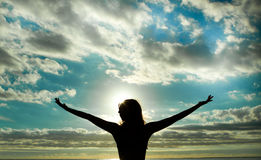 Raised arms during sunset. Woman raised arms during sunset Royalty Free Stock Images