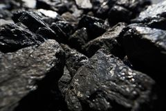 Raised black coal shines in the sunlight royalty free stock image