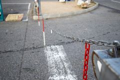 Raised chains at the entrance to the parking area. Prohibit the passage of cars Stock Image