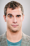 Raised eyebrow expression portrait. A handsome Caucasian man with a raised eyebrow Royalty Free Stock Image
