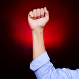 Raised fist of a young man Stock Photo