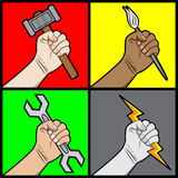 Raised fists holding tools Stock Image
