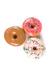 Raised frosted donuts. Isolated on a white background Stock Image