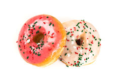 Raised frosted donuts. Isolated on a white background Royalty Free Stock Photo