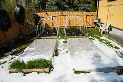 Raised Garden Bed covered with poly film and snow Royalty Free Stock Photography