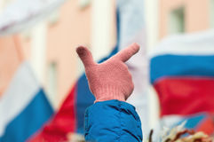 Raised hand on a protest in russia Stock Photo