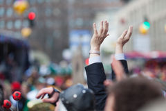 Raised hands in a crowd Stock Images