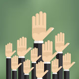 Raised hands on the green background. Royalty Free Stock Photography