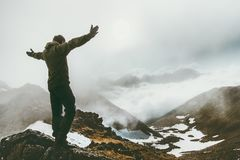 Raised hands Man on foggy mountain summit. Travel success lifestyle survival concept adventure outdoor active vacations wild nature Royalty Free Stock Photos