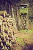 Raised hide in forest. Landscape of field with raised hide and forest. photo with vintage mood effect Royalty Free Stock Image