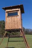 Raised hide. A raised hide for hunting in spring Stock Image