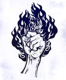 Raised inked hand as a fist gesture with fire burning. Concept of a riot strike, protest fighter symbol. Power sign of freedom revolution. Rights activism Stock Image
