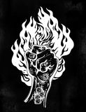 Raised inked hand as a fist gesture with fire burning. Concept of a riot strike, protest fighter symbol. Power sign of freedom revolution. Rights activism Stock Images