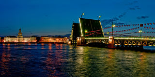 The raised Palace bridge. At white nights in the city of St.-Petersburg stock photos